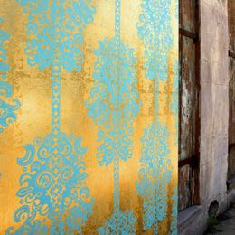 OK I FOUND IT .... THE WALLPAPER FOR THE ONE WALL IN THE DINING ROOM .THE WALL WITH THE TEAL HUTCH AND THE SHINY BRASS KNOBS ! OF COURSE ITS 150.00 A ROLL
