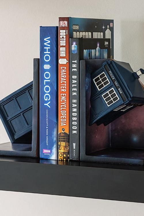 Doctor Who Bookends. Part of the TARDIS on each side of these bookends. Looks like the TARDIS is passing through your books. Cool gadget and geek housewarming gift.