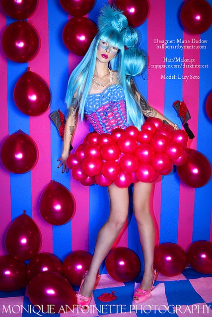 """Balloon dress. Linking instantly into the """"used household"""" theme as the typical designer would not think to use balloons for a dress. It creates the fun and colourful side to the theme."""
