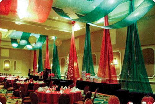 W Drapings Florida: Holiday decorations with fabrics, balloons in red and green with ceiling drapings and custom backdrops