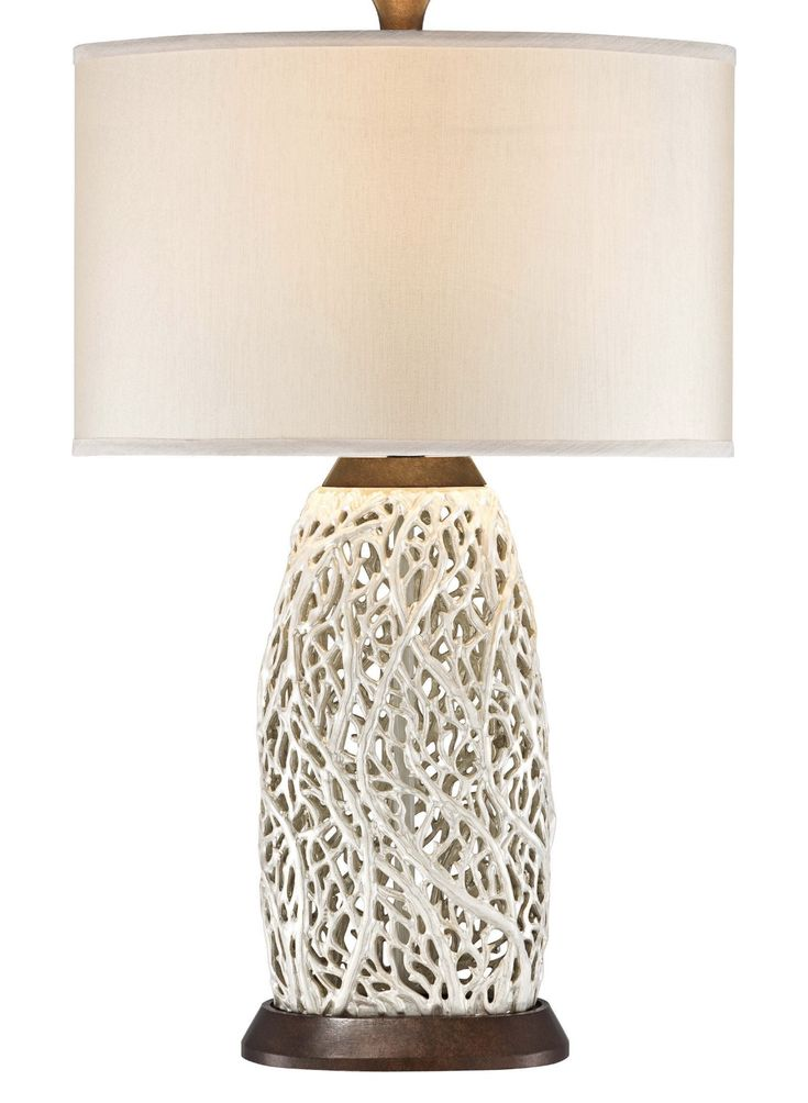 I live how this lamp looks like fan coral.  https://www.houzz.com/product/100436855-seaspray-table-lamp-pearl-white-beach-style-table-lamps