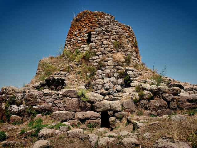Nuraghi & Tombe dei Giganti (Italy). 'Defensive watchtowers, sacred  ritual sites, prehistoric community  centres…the exact purpose of Sardinia's 7000 nuraghi is unknown. Most famous and best preserved is the beehive complex of Nuraghe Su Nuraxi, a Unesco World Heritage site.  Equally mysterious are the island's  tombe dei giganti (giants' tombs),  megalithic mass graves sealed off by stone stele.' http://www.lonelyplanet.com/italy/sardinia