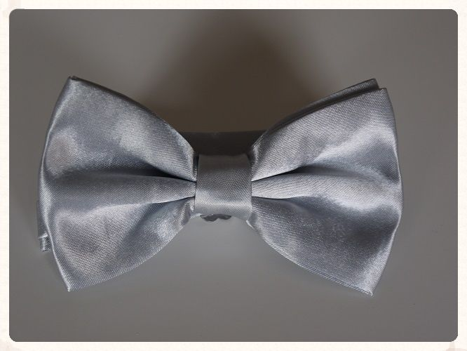 Men rsquo s handmade pre tied bowtie in a grey silver colour with a shiny satin finish Bowties make a great change from the traditional grooms wear