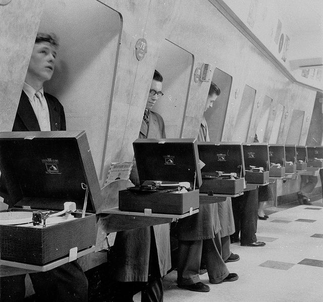 Customers using listening booths in HMV, Oxford Street, London - 1950s. I want to be there please.    by hmv_getcloser, via Flickr