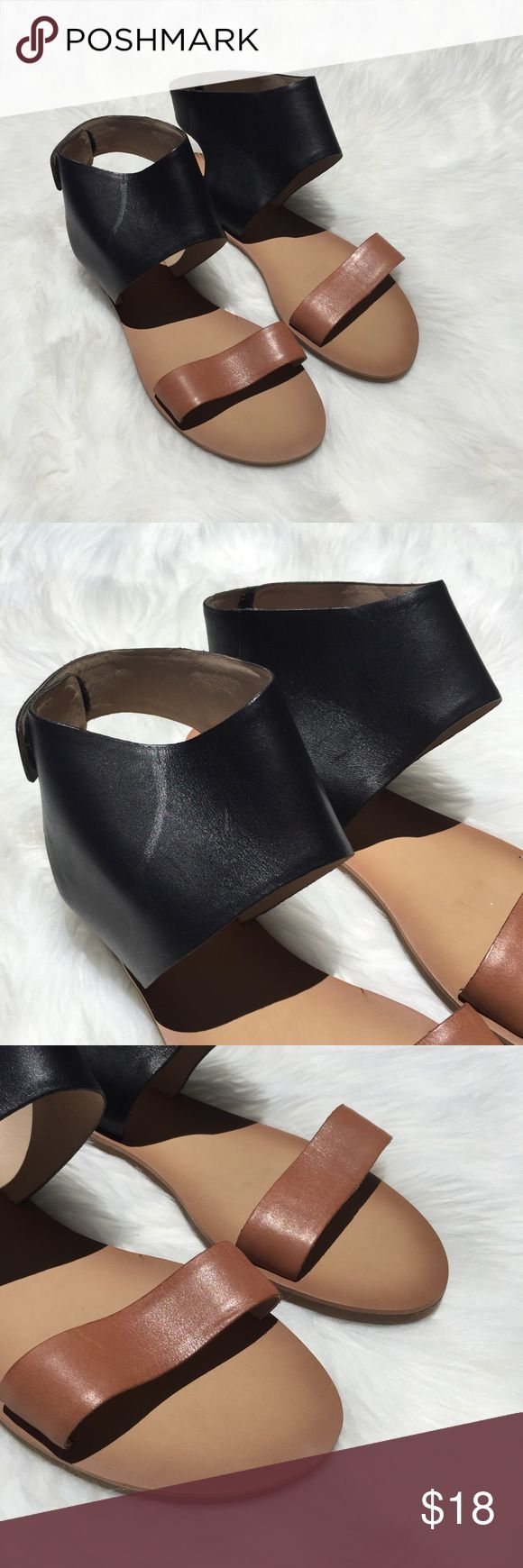 Lucky brand leather open toe ankle strap sandals Size 10 Black ankle strap with beige open toe strap Flat heel New without a box Hook and loop fastener Never been worn sandals. No defects anywhere on the sandals. Lucky Brand Shoes Sandals