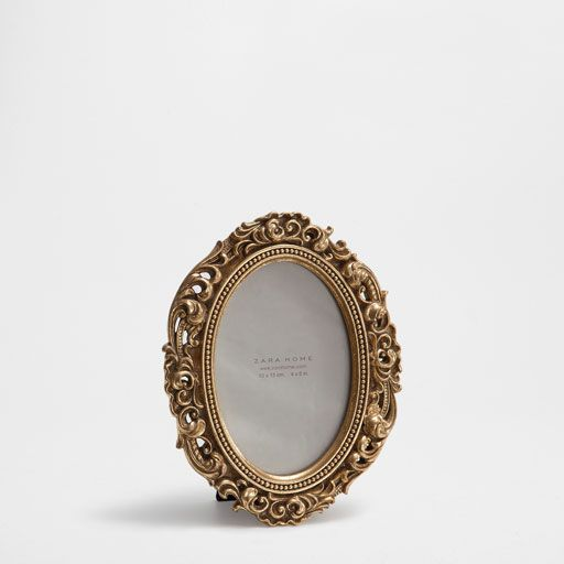 ANTIQUE-FINISH GOLDEN FRAME WITH A RAISED DESIGN