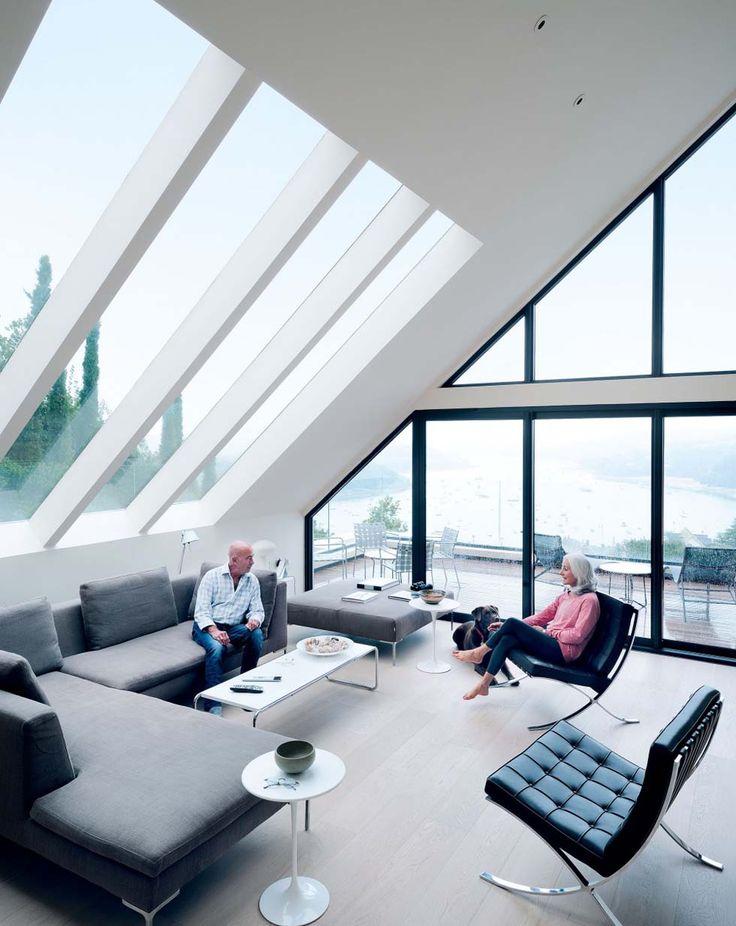 Fixed glazing and sliding doors enable the couple to enjoy estuary views