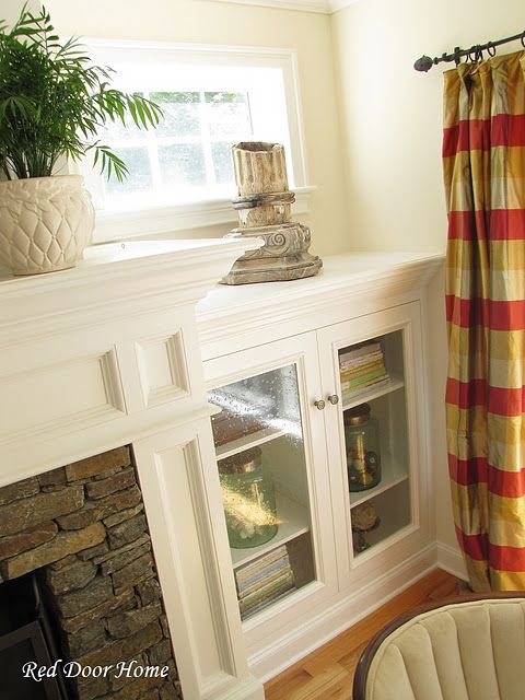 Fireplace Built-ins with Seeded Glass Doors... Love the trim work!
