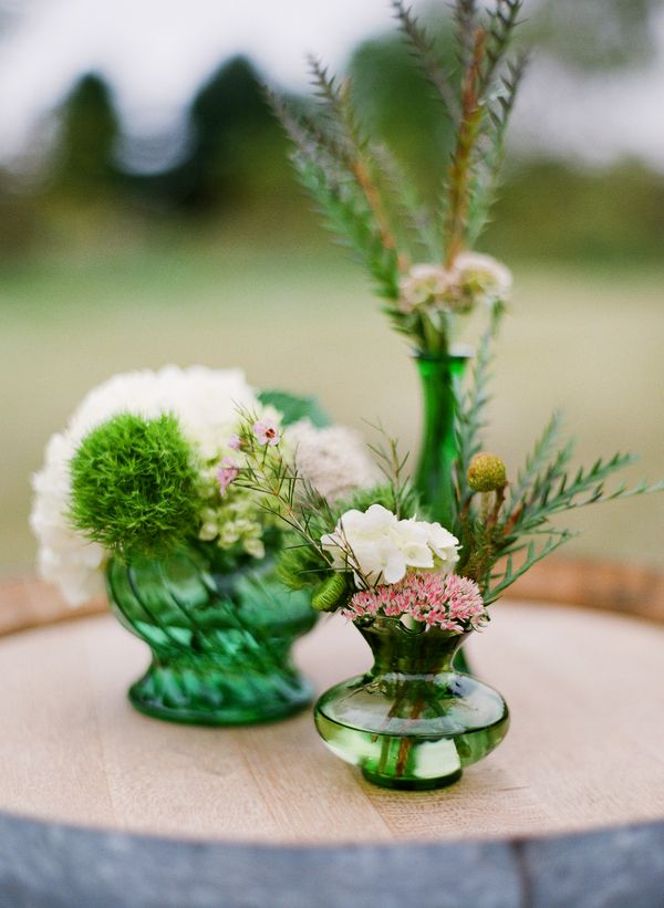 Emerald green vases for wedding centerpieces #emerald #flowers #vase with purple flowers, would be so pretty