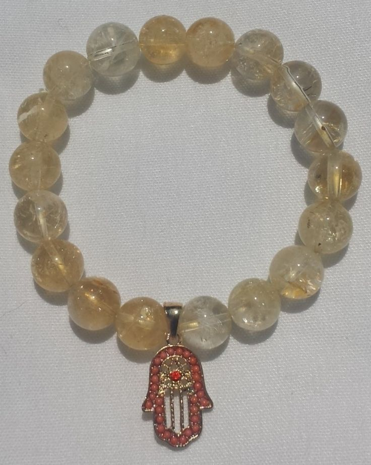 Citrine mala with gold Hamsa for prosperity and to ward off the evil eye