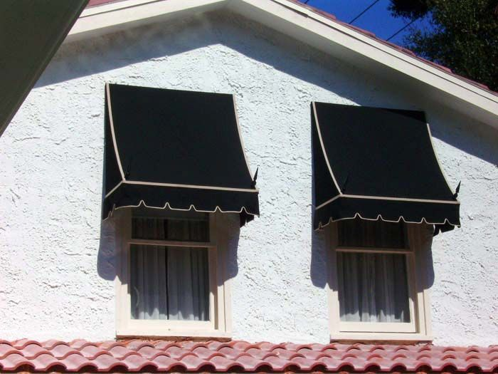 black fabric awning on house with white outlines, fabric side awning, spears