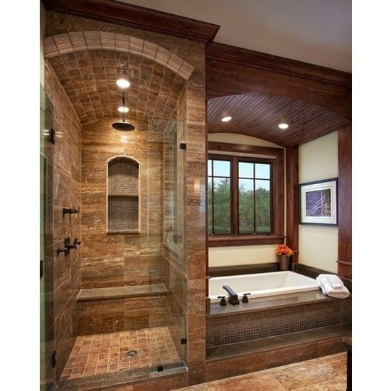 You could so make that shower into a mini steam room.  All you would need is a sauna and a hot tub and you would have your own private spa!