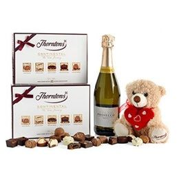 The way to a woman's heart is through chocolate (and champagne). Chocolate gurus Thorntons have got it sorted this year with their #ValentinesDay hampers #Thorntons #Chocolate #Champagne #Teddies