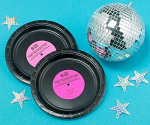 Disco Dance Party Invitation: Type details on color card stock no wider than 3 inches. Trace a soup can around the text and cut. Glue to a small black paper plate for a vintage-record invitation.