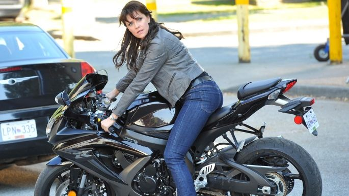 Helen rides a motorcycle