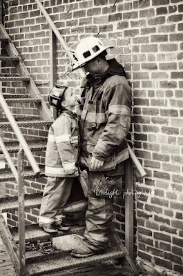 love this shot of a firefighter and his son.