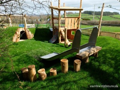 Holne Play Area, Dartmoor. We added a lot to this compact play area in the village of Holne. We provided a basket swing, play tower, slide, tunnel and even a ball wall incorporating a basketball/netball hoop and football goal.