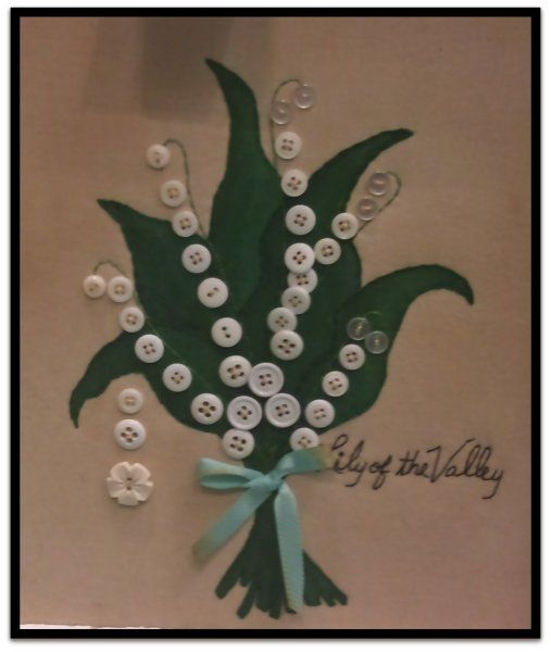 Wee Pearl button art makes these dainty Lily of the valley sprigs on a greeting card.