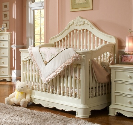 such a sweet nursery. that crib is perfect with the pale pink.