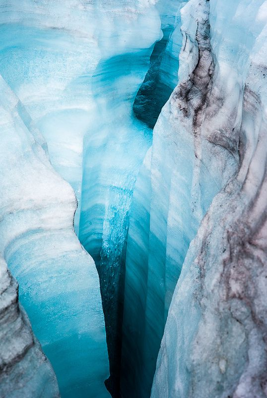 A meltwater stream flowing into a very deep moulin on Rabots Glacier, Kebnekaise.