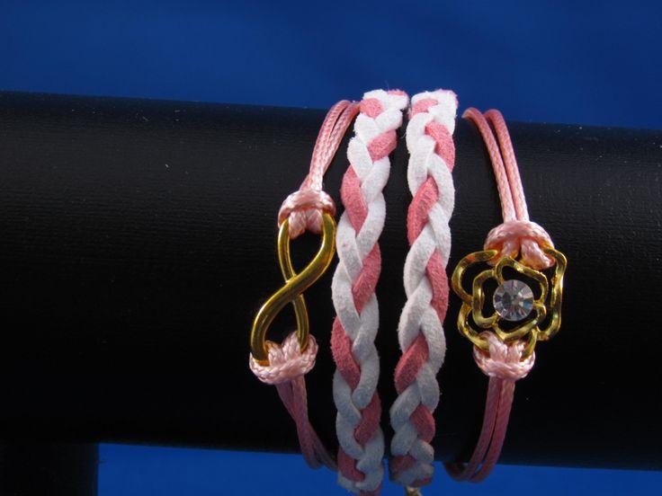 Armband roze-wit met bedel bloem Artikelnummer: 0670 Prijs: € 4,95