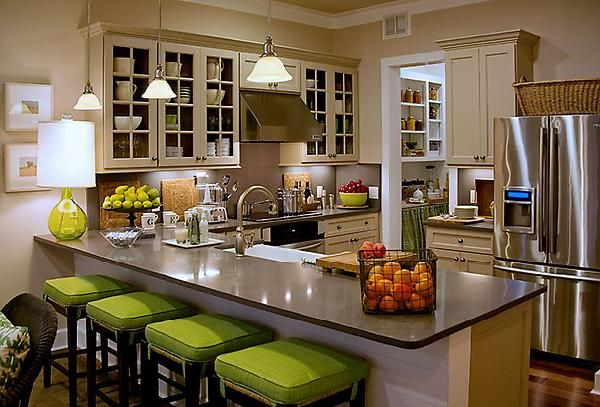 Love the pop of color with the green barstools