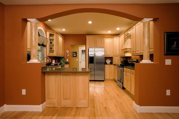 Half walls with 6 round columns elliptical arch for Arch kitchen cabinets