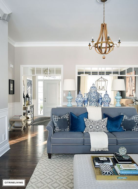 Buffet   Mirrored Buffet   Antique Mirror   living room   open concept home   wood console   ginger jars   blue and white   blue