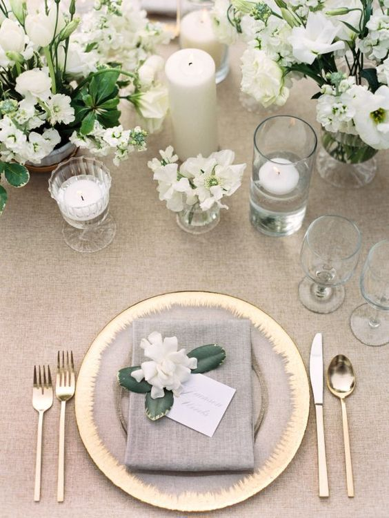 grey, white and gold table setting with white florals