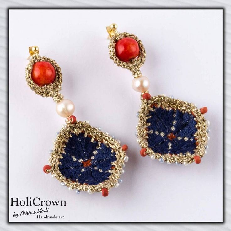 Handmade couture embroidered earrings.
