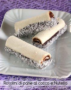 Rotolini di pane al cocco e Nutella e, per dare una nota croccante, li ho arricchiti con un bagno di cioccolato fondente e passati nuovamente nel cocco ..