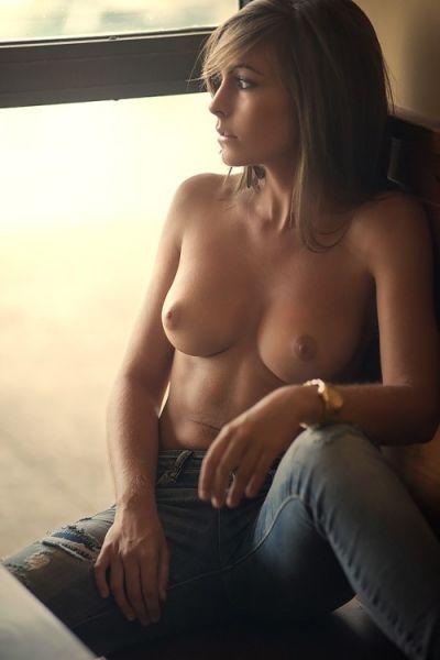 Shoulders beautiful women in blue jeans topless