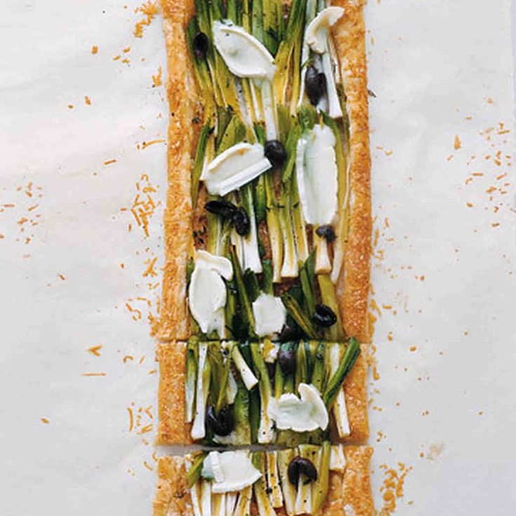 This savory tart brings together meltingly tender leeks, soft ripened and aged cheeses, and a crisp, golden buttery backdrop of store-bought puff pastry.