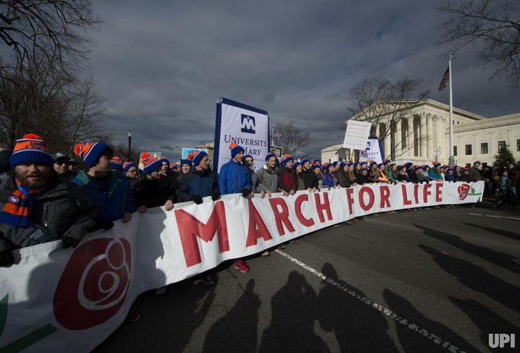 2017 pictures of the year - December 28, 2017:  Demonstrators line up for the March for Life rally outside the U.S. Supreme Court in Washington, D.C., on Jan. 27. Activists from across the nation participated in the annual rally protesting abortion and the 1973 Roe v. Wade Supreme Court decision legalizing abortion. File Photo by Molly Riley/UPI