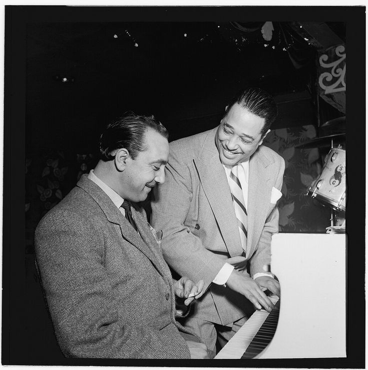 Portrait of Django Reinhardt and Duke Ellington, Aquarium, New York, N.Y., ca. Nov. 1946 (LOC)   Gottlieb, William P., 1917-, photographer.  [Portrait of Django Reinhardt and Duke Ellington, Aquarium, New York, N.Y., ca. Nov. 1946]  1 negative :  b&w ; 2 1/4 x 2 1/4 in.  Notes:  Gottlieb Collection Assignment No. 038 Reference print available in Music Division, Library of Congress. Purchase William P. Gottlieb Forms part of: William P. Gottlieb Collection (Li...