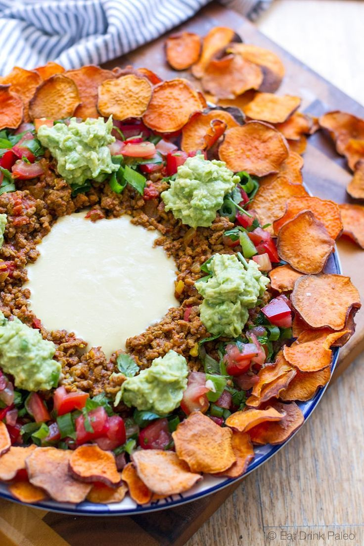 Paleo Nachos with Sweet Potato Chips and Dairy Free Cheese Sauce - low carb, gluten free, primal and clean eating recipe.