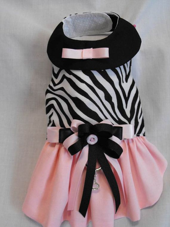 Very sweet dress if you like zebra prints. Top of dress is black & white zreba print cotton and lined with cotton. Skirt is a soft pink cotton fabric and has a black collar with tiny pink bow and a bow at waist in black and pink ribbon. Velcro closures at neck and chest with two inch adjustment for comfortable fit. A d-ring below the waist for attaching a leash. Beautiful model is Roxie. You can use my size chart below or send your pets measurements when you purchase…