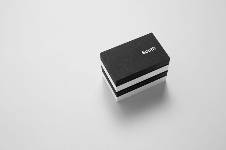 Black business cards with white ink for Auckland based graphic design business Studio South