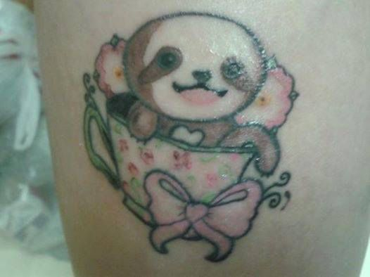 Sloth in a teacup. Covers small scar