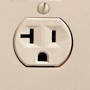 http://www.manufacturedhomerepairtips.com/howtochangeanelectricaloutlet.php has tips for choosing a new outlet & instructions for removing the old one and installing the new one.