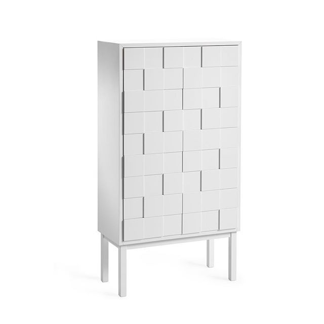 #Swedish designer #SaraLarsson founded the company #A2designers in 2008. Her aim was to produce a range of #Scandinavian #furniture and objects created by local craftspeople in #Småland,  #Sweden.  #Larsson designed the #CollectTall #Cabinet in #2010. It is a follow up to her colourful collect cabinet created in 2008.  While the #cupboard appears in a pure #white to match many Scandinavian #interiors, the doors have a unique raised square texture, which gives it an almost woven appearance…