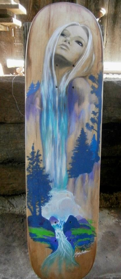 skateboard deck painted by  Lydia Martin