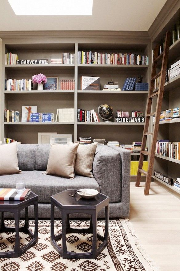 Cozy library with ladder and neutral sofa with lots of pillows