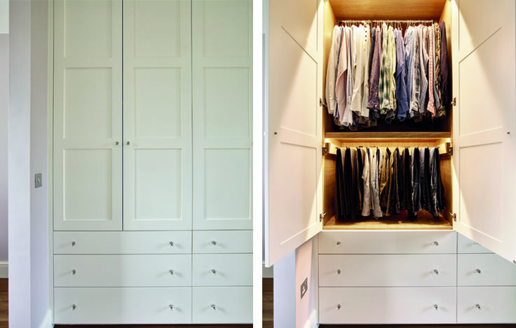 Large, modern white shaker style fitted wardrobes for dressing area.