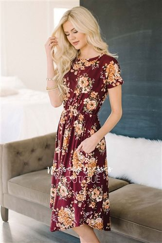 You will want to cram your closet full of these super soft, super cute floral dresses for fall! This burgundy dress features a gold floral print, has an elastic waist and long sleeves, and adorable front pockets!