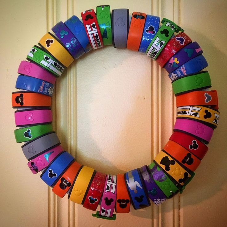 Magic Bands on display! Easy DIY wreath to remember all of our trips to Disney World!