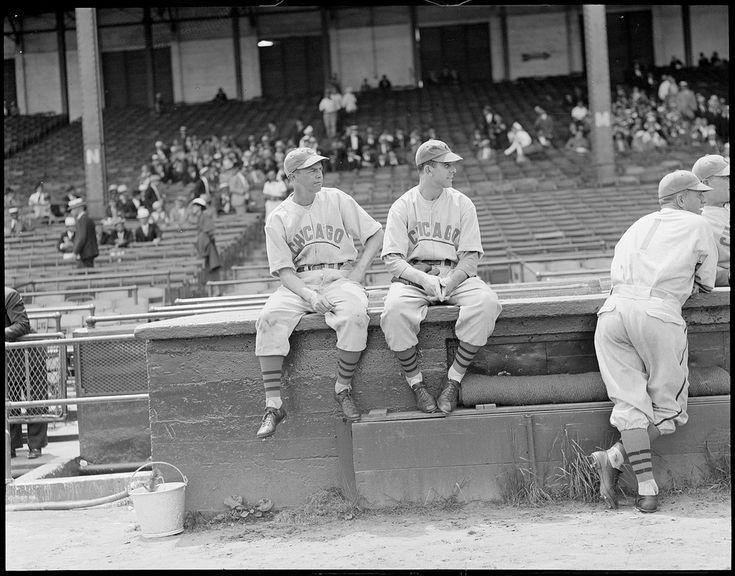 https://flic.kr/p/a5Kasx | Chicago Cubs players, Braves field | File name: 08_06_011154  Title: Chicago Cubs players, Braves field   Creator/Contributor: Jones, Leslie, 1886-1967 (photographer)   Date created: 1937   Physical description: 1 negative : glass, black & white ; 4 x 5 in.  Summary: (l to r:) Chicago Cubs Stan Hack and Phil Cavaretta sitting on top of the dugout at Braves Field.