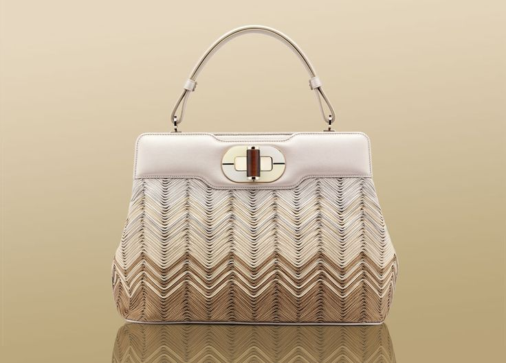 Bulgari's Isabella Rossellini hang bag. The craftsmanship and variety on this bag is unbelievable
