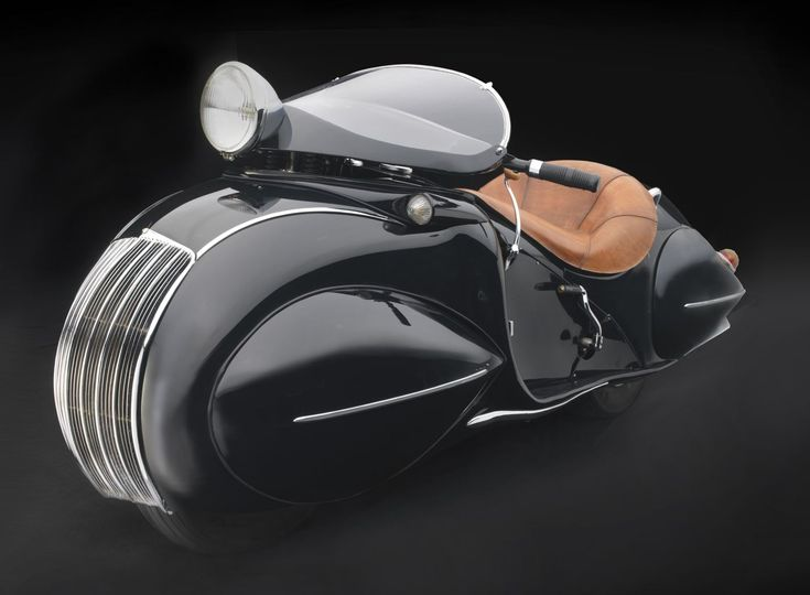 With its 1,200-cc, 40-brake horsepower, in-line four-cylinder engine, the 1930 Henderson Model KJ Streamline could exceed 100 mph. In an era when streamlining was used sparingly in motorcycle design, American Orley Ray Courtney's enclosed bodywork was virtually unknown on production two-wheelers (except for a few racing machines), making the KJ an unusual and beautiful example of Art Deco design.