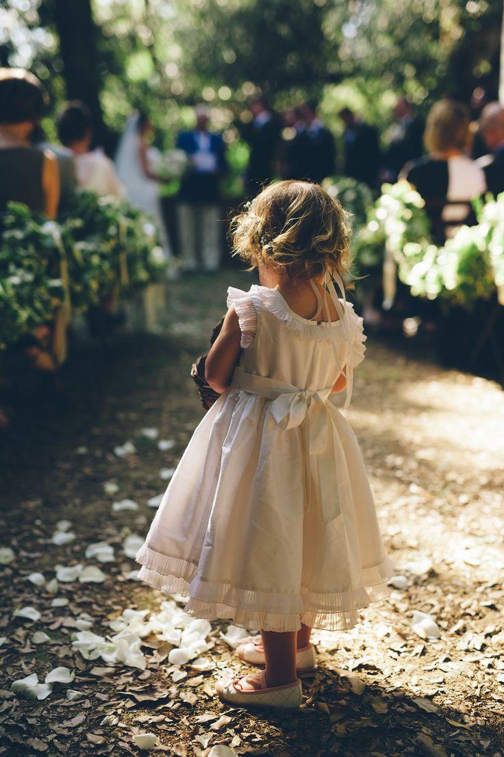 This may be my favorite photo from our wedding! Coco finally decided to toss the flower petals during the ceremony. I loved her outfit so much! My friend Johanna found Coco's shoes while they were traveling in Portofino a few days before the wedding, and her dress was made of Italian silk.